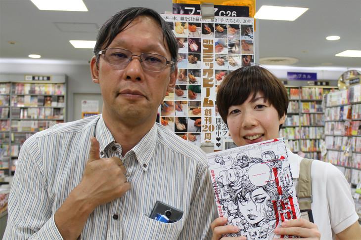 奥村勝彦編集総長と、紀伊國屋書店新宿本店フォレストの早乙女直美さん。