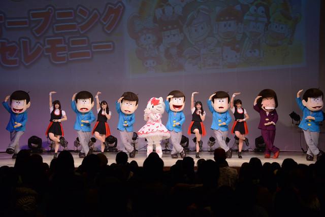 「シェー」のポーズをキティちゃんに披露する6つ子とA応P。