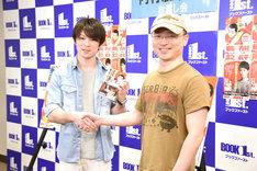内村航平選手(左)と、会場に駆けつけた菊田洋之(右)。