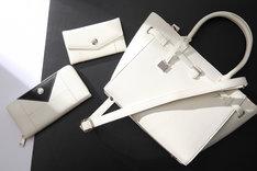 有馬貴将モデルのバッグ、財布、スマートフォンケース。