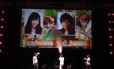 スクリーンにバズーカを撃ち、市ノ瀬加那と中村悠一の出演を発表する稲垣理一郎。