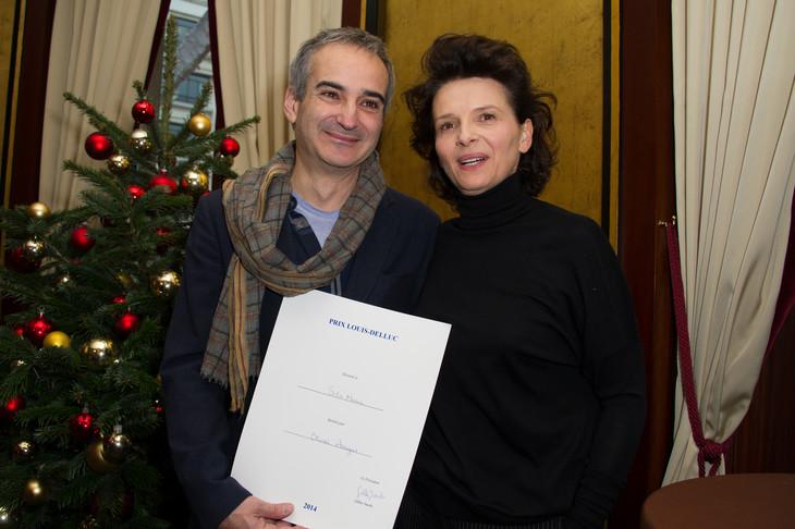 オリヴィエ・アサイヤス(左)とジュリエット・ビノシュ(右)。(写真提供:Abaca Press / Orban Thierry / Sipa USA  / Newscom / ゼータ イメージ)