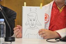 なぜか港カヲルが描いた、バイト君の新妻「まきさん」の似顔絵。