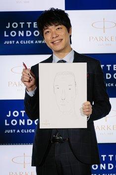 相方・田村の似顔絵を描いた麒麟・川島。