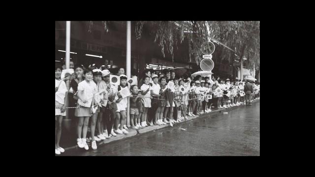 火田聖一が初めて聖火ランナーを見たときの写真。