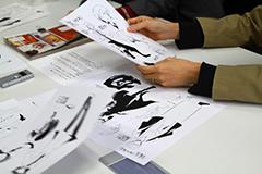 設定画を見ながら中島敦のキャラクターを語る朝霧カフカ。